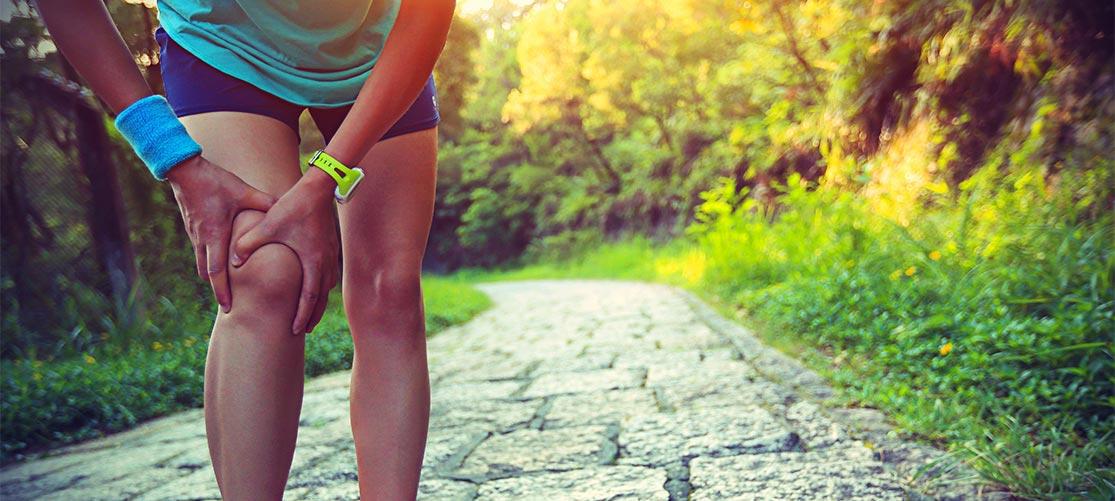Runner holding injured knee